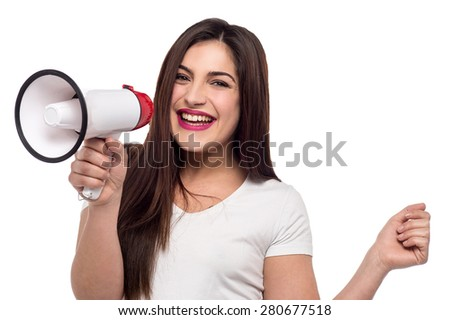 Cheerful woman proclaiming over megaphone - stock photo