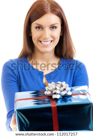 Cheerful woman showing gift, isolated over white background