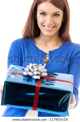 Cheerful woman showing gift, isolated over white background - stock photo