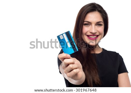 Cheerful woman showing her credit card to camera - stock photo