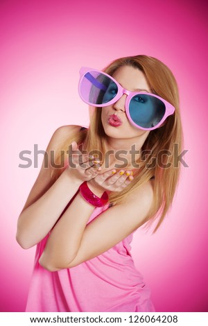 Cheerful woman with over sized sunglasses - stock photo
