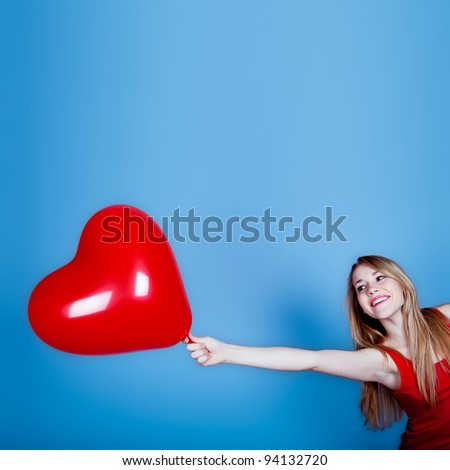 Cheerful woman with red heart - stock photo