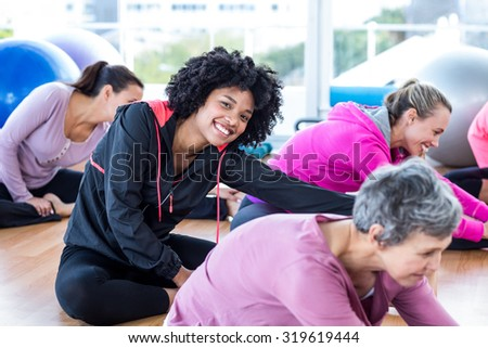Cheerful women exercising in fitness studio - stock photo