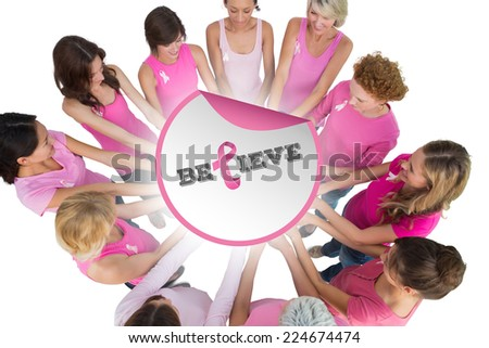 Cheerful women joined in a circle and looking at each otherwearing pink for breast cancer against breast cancer awareness message - stock photo