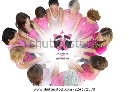 Cheerful women joined in a circle wearing pink for breast cancer against breast cancer awareness message - stock photo