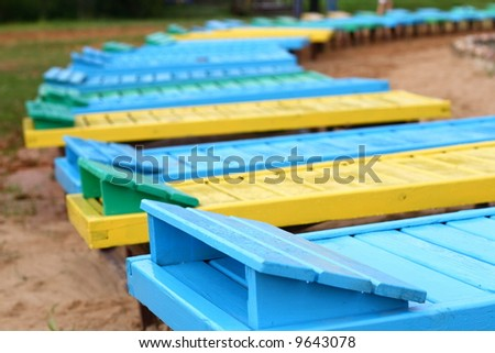 Cheerful wooden deck-chairs
