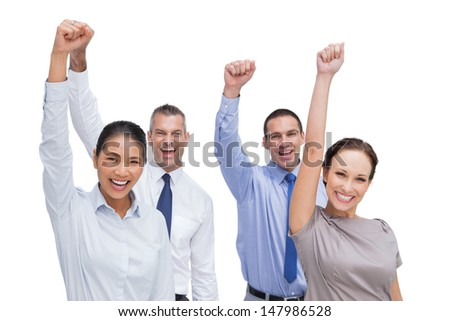 Cheerful work team posing with hands up on white background - stock photo