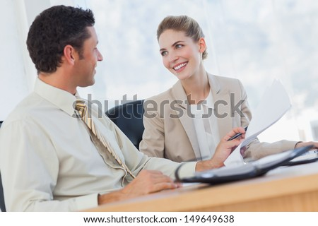 Cheerful workmates working together in their office - stock photo