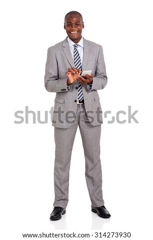 cheerful young african american businessman using cell phone - stock photo