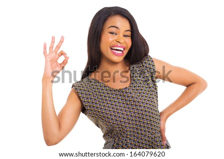 cheerful young african woman giving okay sign - stock photo