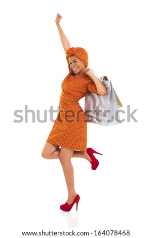 cheerful young african woman holding shopping bags isolated on white - stock photo