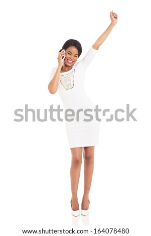 cheerful young african woman talking on cell phone isolated on white - stock photo