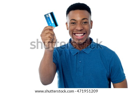 Cheerful young an showing his credit card to camera.