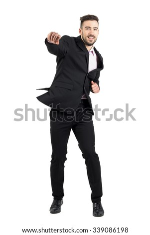 Cheerful young bearded business man jumping excited with clenched fists. Full body length portrait isolated over white studio background.  - stock photo