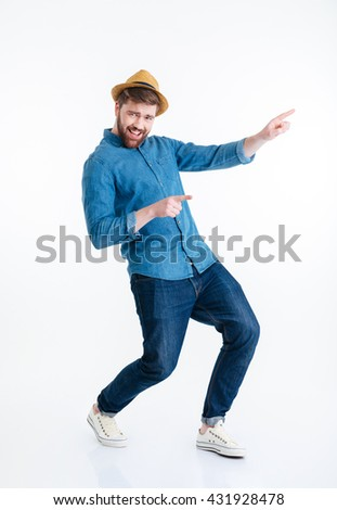 Cheerful young bearded man dancing isolated on the white background - stock photo