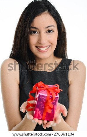 cheerful young beautiful brunette woman holding out gift - stock photo