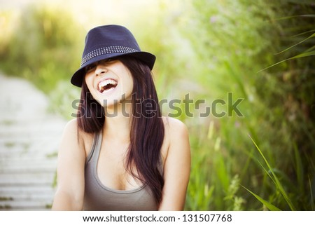Cheerful young beautiful woman in nature