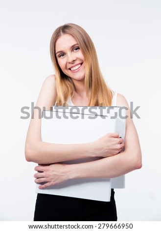 Cheerful young business woman holding folders isolated on a gray background. Looking at camera - stock photo
