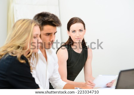 cheerful young business woman with partners in  meeting room - stock photo