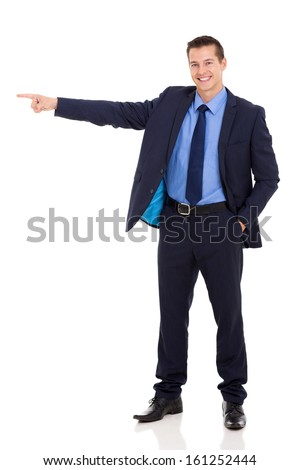 cheerful young businessman pointing on white background - stock photo