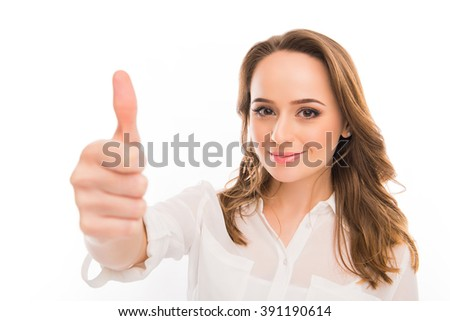 "Cheerful young businesswoman gesturing ""LIKE"", close up photo - stock photo"