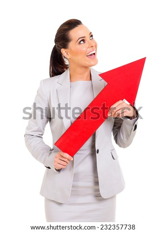 cheerful young businesswoman holding direction arrow pointing up - stock photo