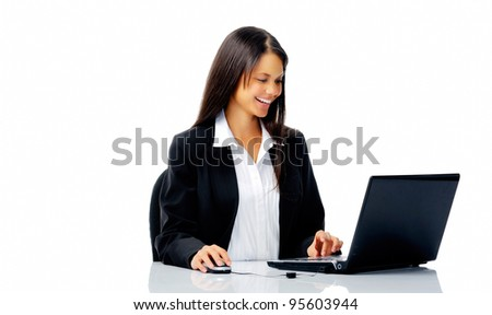 cheerful young businesswoman working at her computer isolated on white