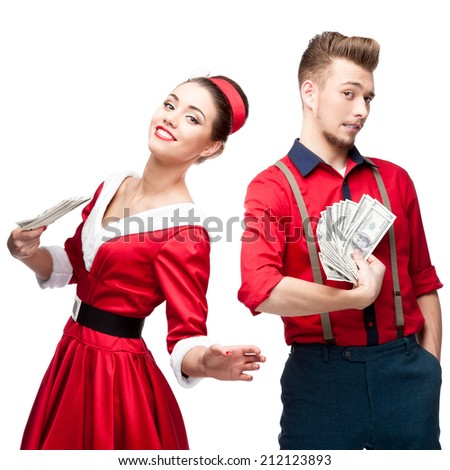 cheerful young caucasian couple in red vintage clothing holding money isolated on white