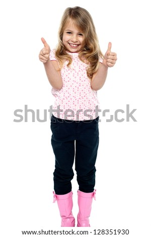 Cheerful young caucasian girl showing double thumbs up to the camera. - stock photo