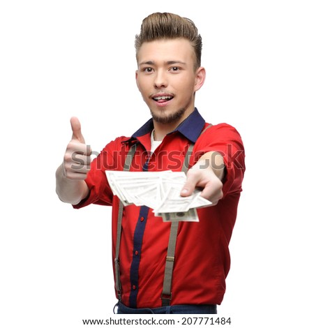 cheerful young caucasian man in red vintage clothing holding money and showing thumb up - stock photo