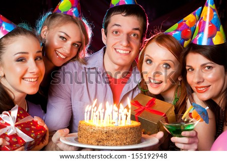 cheerful young company celebrates birthday in a nightclub - stock photo