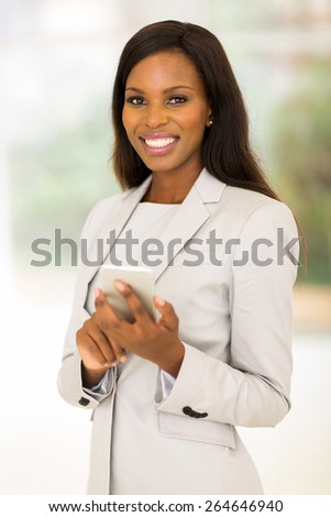 cheerful young corporate worker using cell phone - stock photo