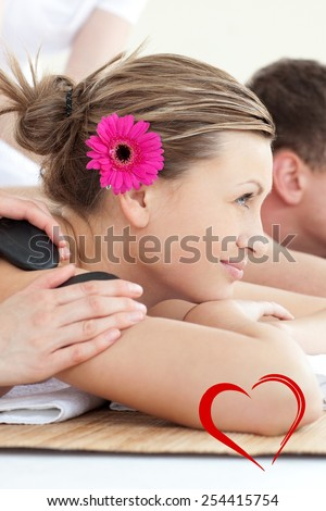 Cheerful young couple enjoying a Spa treatment against heart