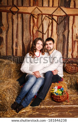 Cheerful young couple expecting a baby. Beautiful spring interior - stock photo