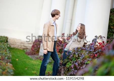Cheerful young couple having a date in park - stock photo
