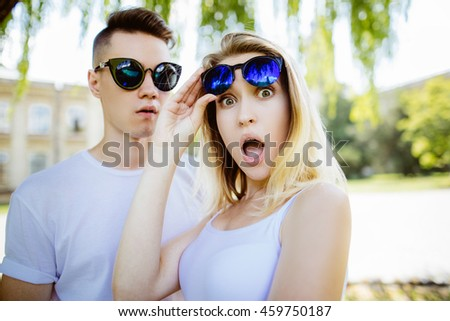 cheerful young couple having fun in the summer park