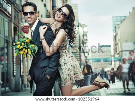 Cheerful young couple on a city street - stock photo