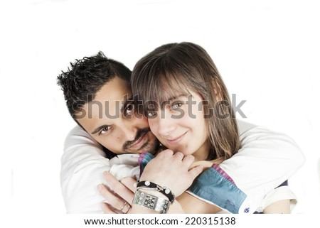Cheerful young couple standing on white background, isolated - stock photo