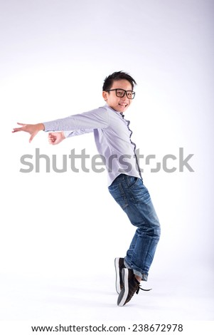 Cheerful young dancer performing freeze move on his toes - stock photo