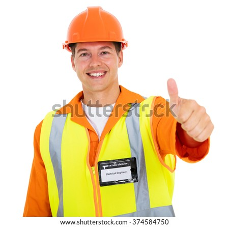 cheerful young electrician thumb up - stock photo