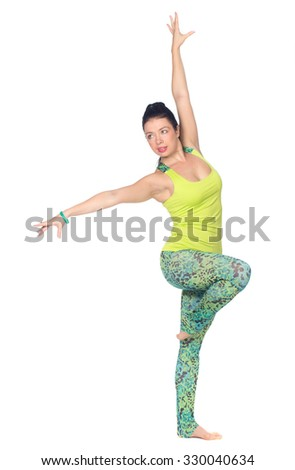 Cheerful young exercising woman doing yoga, isolated over white background