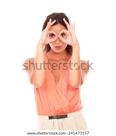 Cheerful young female with finger up gesturing glasses while looking at you in white background