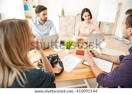 Cheerful young freelancers are working together - stock photo