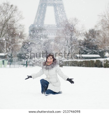 Cheerful young girl enjoying winter day in Paris - stock photo