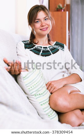 Cheerful young girl in casual clothing at home interior - stock photo