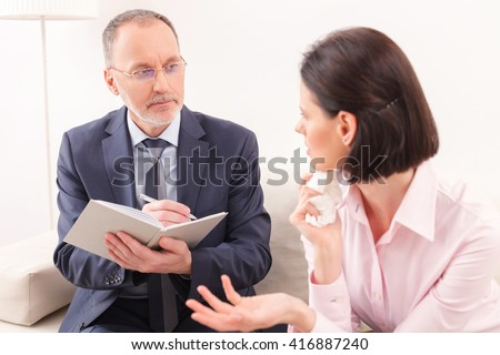 Cheerful young girl is visiting a psychologist - stock photo