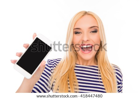 Cheerful young girl showing black screen of smartphone - stock photo