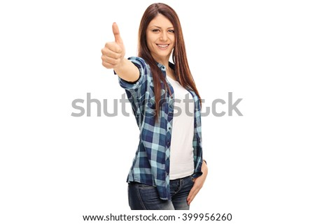 Cheerful young girl with braces giving a thumb up and looking at the camera isolated on white background - stock photo