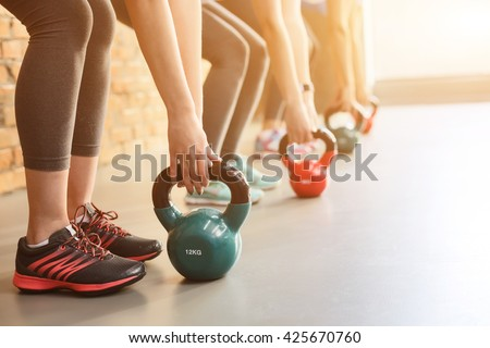 Cheerful young girls are training their body - stock photo