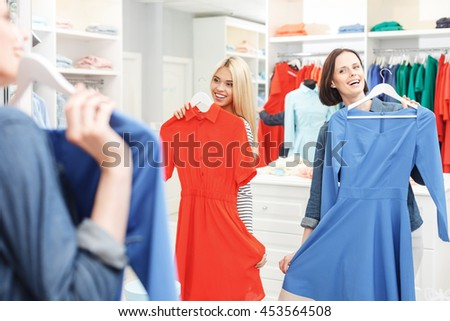 Cheerful young girls having fun in shop - stock photo
